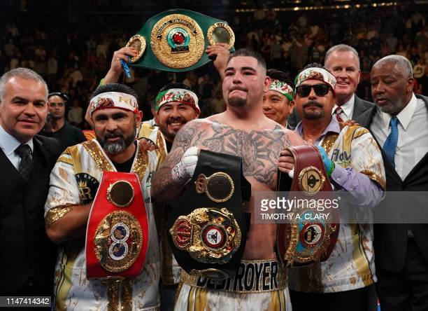 USA's Andy Ruiz celebrates after knocking down England's Anthony Joshua in the 7th round to win by TKO during their 12round IBF WBA WBO IBO World...