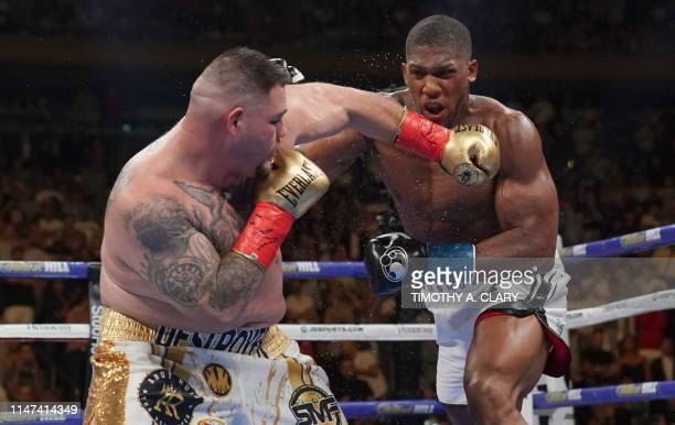 USA's Andy Ruiz fights against England's Anthony Joshua in the 7th round to win by TKO during their 12round IBF WBA WBO IBO World Heavyweight...