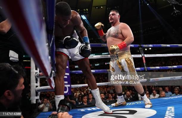 USA's Andy Ruiz fights with England's Anthony Joshua during their 12round IBF WBA WBO IBO World Heavyweight Championship fight at Madison Square...