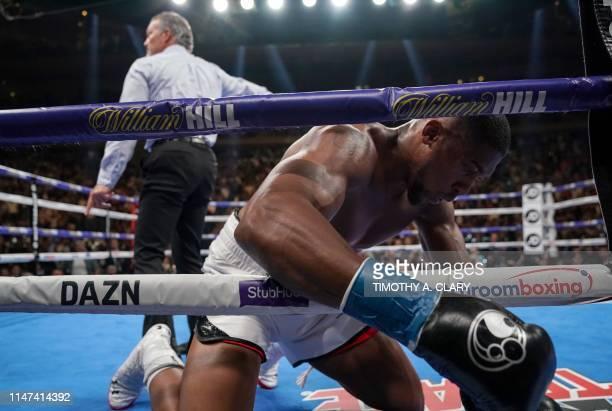 USA's Andy Ruiz knocks down England's Anthony Joshua during their 12round IBF WBA WBO IBO World Heavyweight Championship fight at Madison Square...