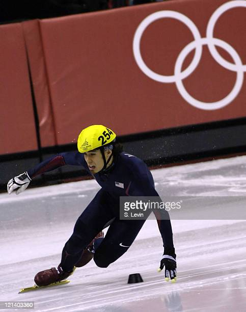 USA's Apolo Anton Ohno stumbles in the Mens 1500 M Short Track event at the Palavela venue in Torino Italy on February 12 2006
