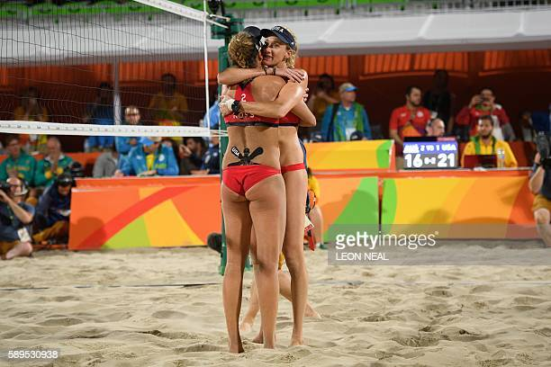 USA's April Ross and Kerri Walsh Jennings celebrate after defeating Australia in the women's beach volleyball quarterfinal match at the Beach Volley...
