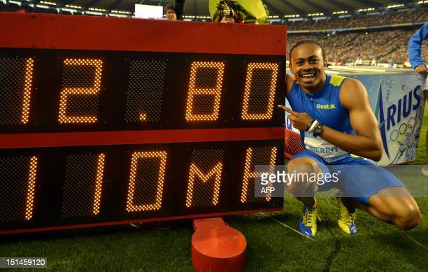 S Aries Merritt celebrates his new world record of 12.80 seconds in the Men's 110m hurdles event during the Memorial Ivo Van Damme Diamond League...