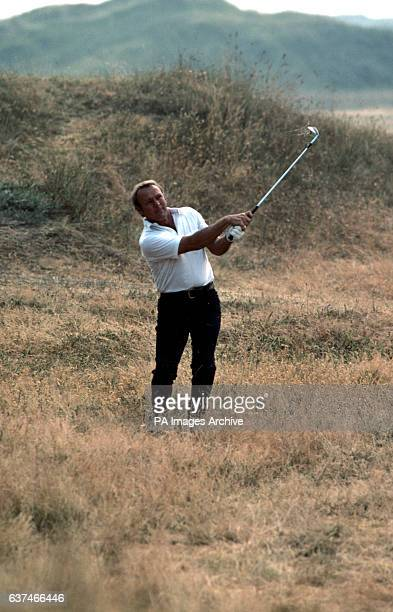USA's Arnold Palmer plays a shot out of the rough