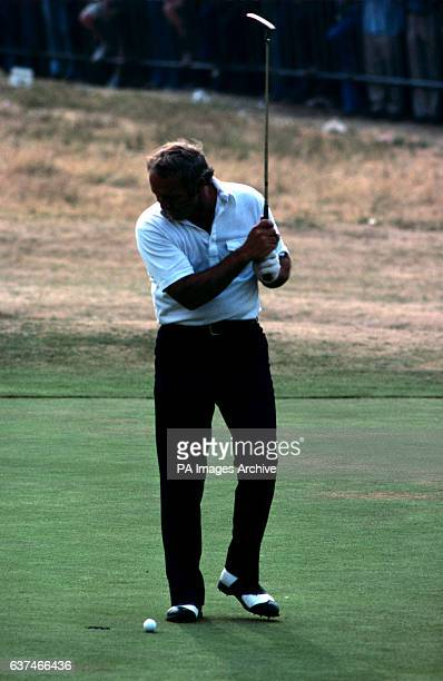 USA's Arnold Palmer threatens the ball with his club as he misses a putt