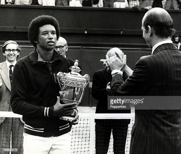 1975 USA's Arthur Ashe pictured with the Wimbledon Mens Singles Championship trophy after beating Jimmy Connors in the Final with HRH Duke of Kent...