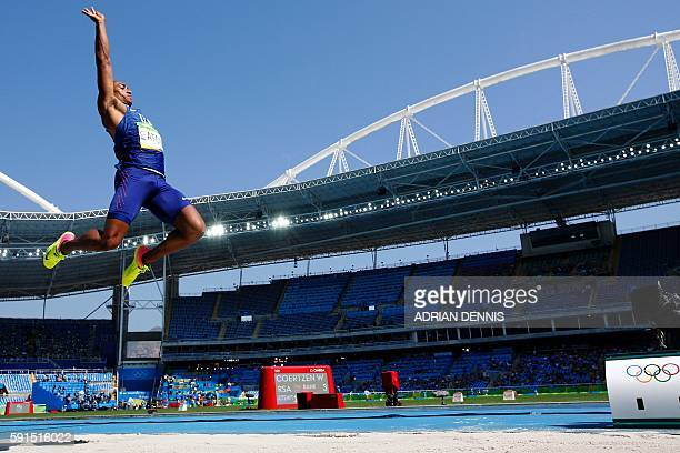 S Ashton Eaton competes in the Men's Decathlon Long Jump during the athletics event at the Rio 2016 Olympic Games at the Olympic Stadium in Rio de...