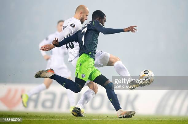 S Austrian defender Gernot Trauner and Sporting's Portuguese midfielder Rafael Camacho vie for the ball during the UEFA Europa League Group D...
