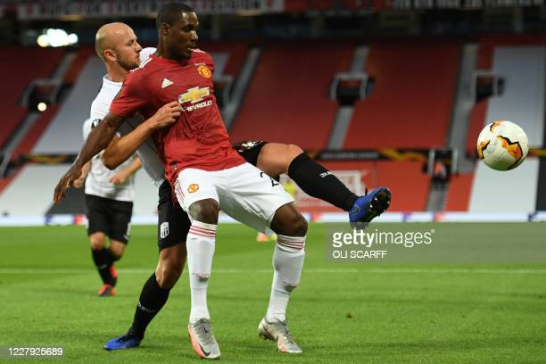 S Austrian defender Gernot Trauner vies with Manchester United's Nigerian striker Odion Ighalo during the UEFA Europa League last 16 second leg...