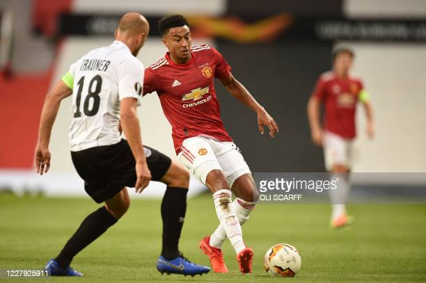 LASK's Austrian defender Gernot Trauner vies with Manchester United's English midfielder Jesse Lingard during the UEFA Europa League last 16 second...