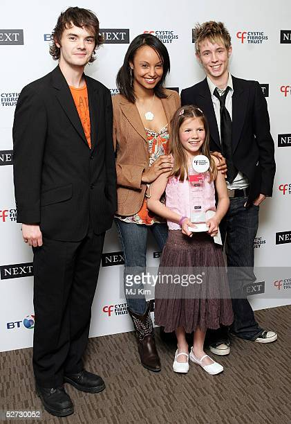 CBBC's Barney Harwood Gemma Hunt and Matt Edmonds pose with 10yearold Amy Potter who received the Junior NEXT award at the Royal Lancaster Hotel on...