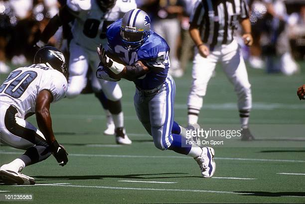 PHILADELPHIA PA CIRCA 1990's Barry Sanders of the Detroit Lions carries the ball against the Philadelphia Eagles circa early 1990's during an NFL...