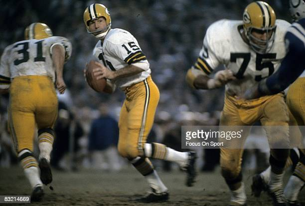 BALTIMORE MD CIRCA 1960's Bart Starr quarterback of the Green Bay Packers drops back to pass against the Baltimore Colts during a circa 1960's NFL...