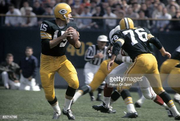 BAY WI CIRCA 1960's Bart Starr quarterback of the Green Bay Packers drops back to pass against the St Louis Cardinals during a circa 1960's NFL game...