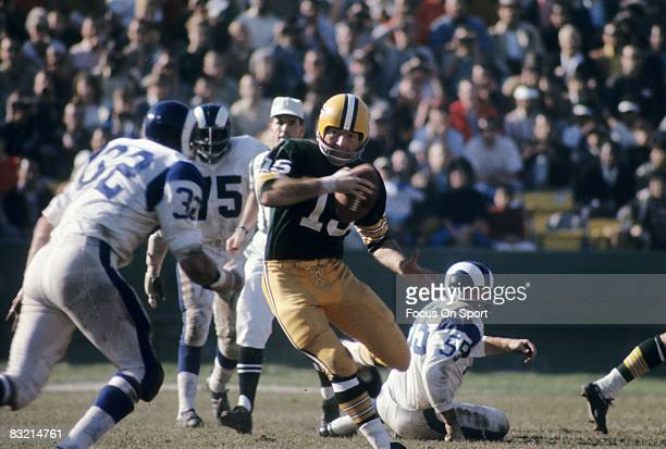 BAY WI CIRCA 1960's Bart Starr quarterback of the Green Bay Packers scrambles against the Los Angeles Rams during a circa 1960's NFL game at Lambeau...