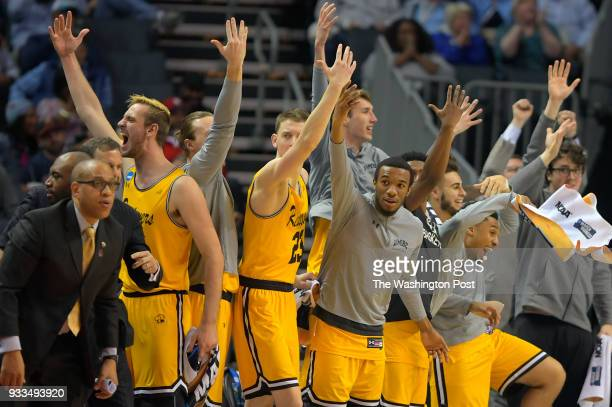 UMBC's bench erupts as they score a 2nd half basket pulling away during UMBC's upset of the University of Virginia in the 1st round for the mens NCAA...