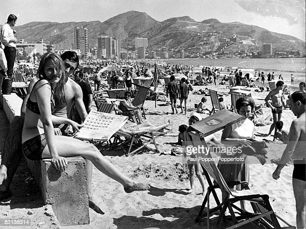 1960's Benidorm Spain A general view of a continental beach scene with many people sunbathing