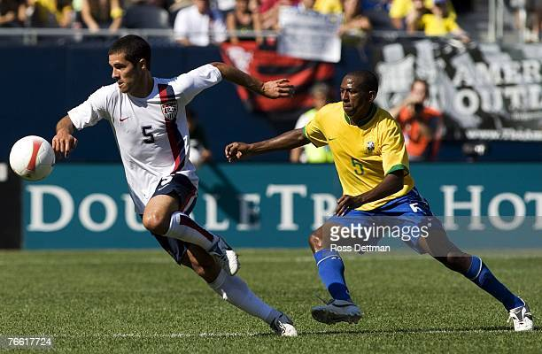 USA's Benny Feilhaber moves the ball away from Mineiro of Brazil during the international friendly match between Brazil and the US Men's National...