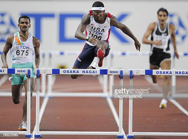 USA's Bershawn Jackson competes infront of India's Joseph G Abraham and Pakistan's Haq Nawaz during the mens 400m hurdles first round 25 August 2007...