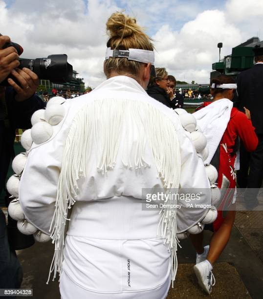 USA's Bethanie MattekSands arrives for her match against Japan's Misaki Doi wearing a distinctive jacket on day three of the 2011 Wimbledon...