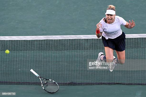 TOPSHOT USA's Bethanie MattekSands celebrates after she and USA's Jack Sock beat USA's Venus Williams and USA's Rajeev Ram in their mixed doubles...