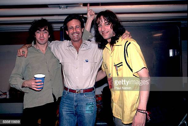 REM's Bill Berry Gary Zeckley and Peter Buck pose backstage DeKalb Illinois October 21 1986