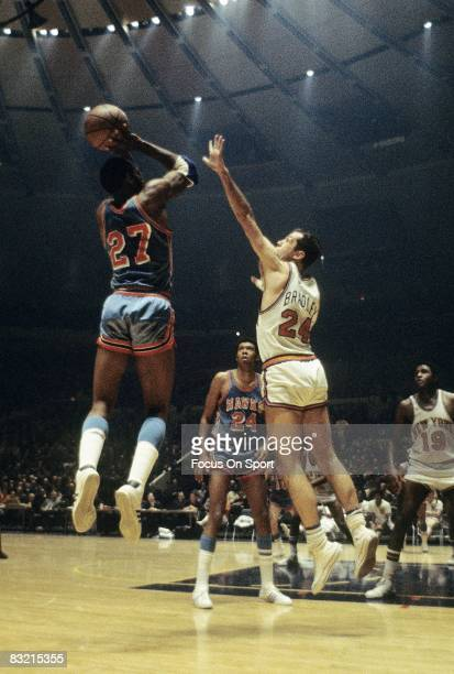 NEW YORK NY CIRCA 1970's Bill Bradley of the New York Knicks defends the jumpshot of an Atlanta Hawks shooter during a early circa 1970's NBA...