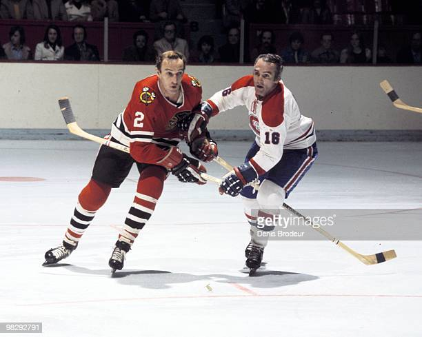 MONTREAL 1970's Bill White of the Chicago Blackhawks skates against Henri Richard of the Montreal Canadiens in the 1970's at the Montreal Forum in...