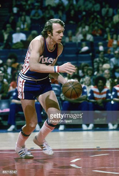BALTIMORE MD CIRCA 1970's Billy Cunningham of the Philadelphia 76ers drives to the basket against the Baltimore Bullets during an early circa 1970's...
