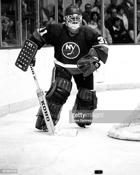 BOSTON MA 1970's Billy Smith of the New York Islanders plays puck behind net in game against the Boston Bruins at the Boston Garden