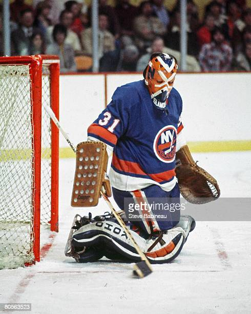 Billy Smith of the New York Islanders tends goal in game against the Boston Bruins at the Boston Garden.