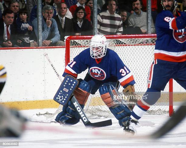 BOSTON MA 1980's Billy Smith of the New York Islanders tends goal in game against the Boston Bruins at the Boston Garden