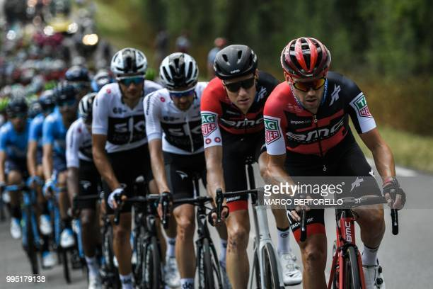 USA's BMC Racing cycling team riders New Zealand's Patrick Bevin and US Tejay Van Garderen take a relay at the head of the pack chasing a fourmen...