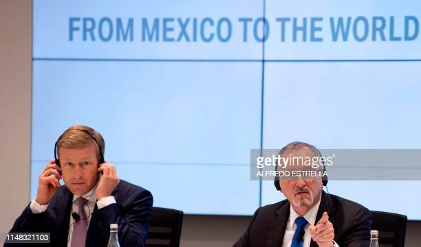 BMW AG's board of management member Oliver Zipse and the vicepresident of BMW Communications Strategy Bill McAndrews offer a press conference before...