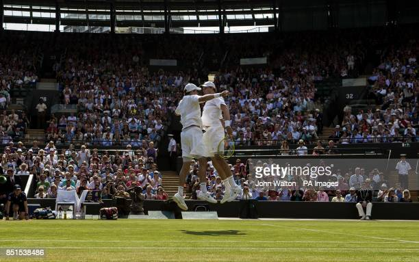 USA's Bob and Mike Bryan celebrate beating India's Rohan Bopanna and France's Edouard RogerVasselin in the Mens Doubles with a jumping chest bump...