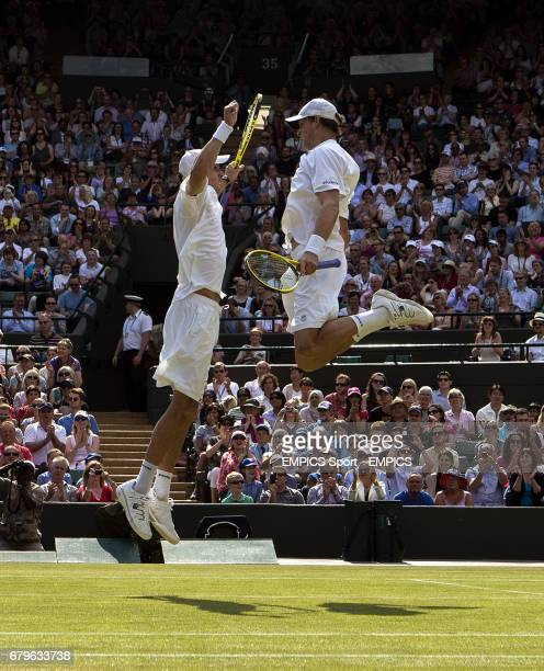USA's Bob and Mike Bryan celebrates beating India's Rohan Bopanna and France's Edouard RogerVasselin in the Mens Doubles with a jumping chest bump