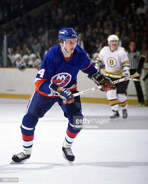 BOSTON MA 1980's Bob Bourne of the New York Islanders skates against the Boston Bruins at Boston Garden