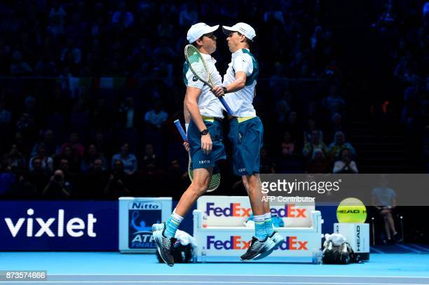 S Bob Bryan and USA's Mike Bryan celebrate beating Britain's Jamie Murray and Brazil's Bruno Soares during their men's doubles match on day two of...