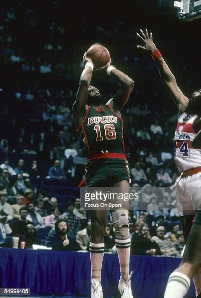 BALTIMORE MD CIRCA 1980's Bob Lanier of the Milwaukee Bucks in action shooting over Rick Mahorn of the Washington Bullets during a early circa 1980's...