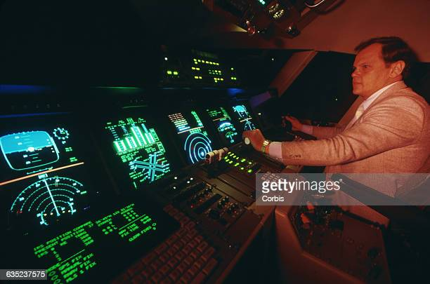 NASA's Bob Shiner 'flies' in the test cockpit of a sophisticated flight simulator for the Orient Express a hypersonic airplane still in development...