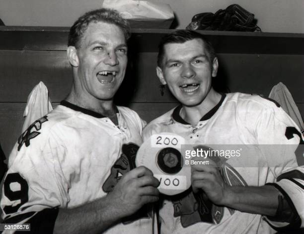 CHICAGO 1960's Bobby Hull and Stan Mikita of the Chicago Black Hawks celebrate in the locker room after their game