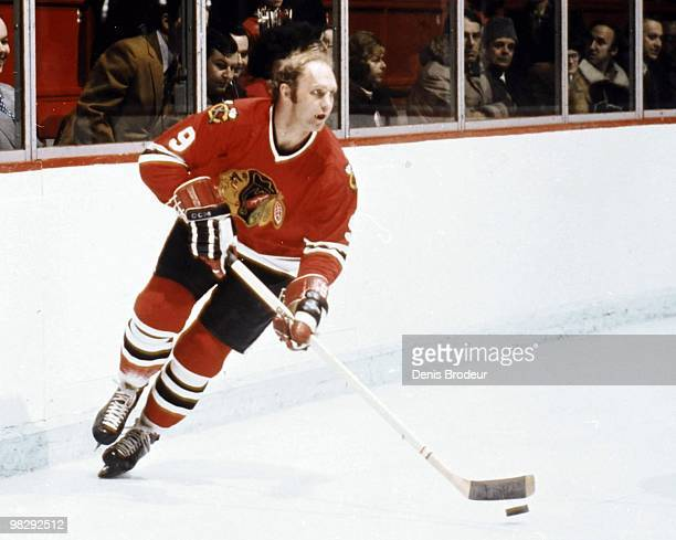 Bobby Hull of the Chicago Blackhawks skates with the puck against the Montreal Canadiens in the 1970's at the Montreal Forum in Montreal, Quebec,...