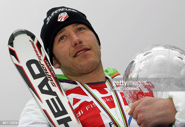 USA's Bode Miller poses with the large crystal globe at the FIS Ski World Cup Grand Finals in Bormio on March 16 2008 Miller won the overall World...
