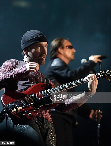U2's Bono and The Edge performs on the band's sold out Vertigo tour May 9 2005 at the United Center in Chicago Illinois