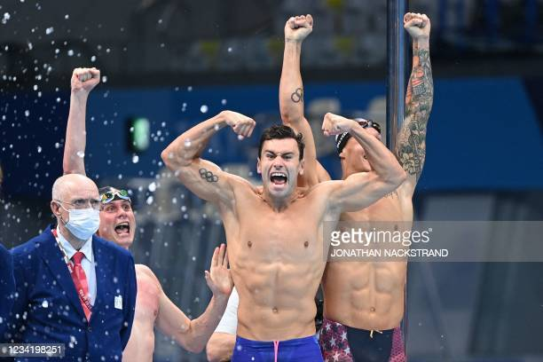 S Bowen Becker, Blake Pieroni and Caeleb Dressel celebrate as USA's Zach Apple touched in first to win and take gold in the final of the men's 4x100m...