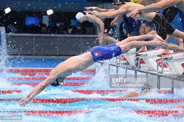 S Bowen Becker dives to to compete in the final of the men's 4x100m freestyle relay swimming event during the Tokyo 2020 Olympic Games at the Tokyo...
