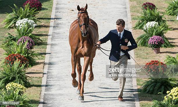 USA's Boyd Martin leads Blackfoot Mystery to a trot during the first horse inspection of the Equestrian's Eventing phase during the 2016 Rio Olympic...