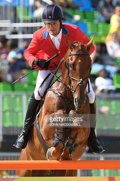 USA's Boyd Martin on Blackfoot Mystery competes during the Eventing's Individual Jumping of the Equestrian during the 2016 Rio Olympic Games at the...