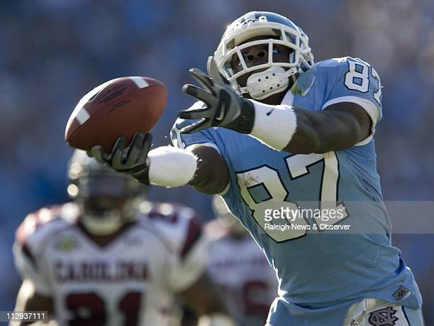 UNC's Brandon Tate has his hand on the ball but can't control this pass from quarterback T J Yates during the second quarter of play against South...