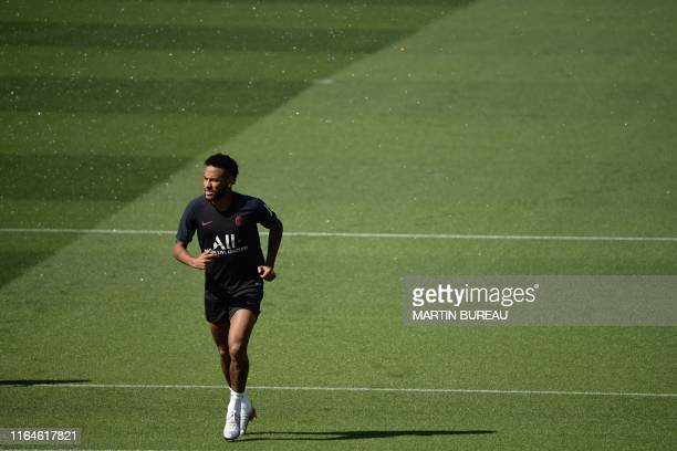 TOPSHOT PSG's Brazilian forward Neymar attends a training session in Ooredoo training center in SaintGermainenLaye on August 29 2019